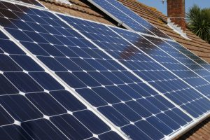 Solar panels for electricity generation on domestic house roof in Sussex. England